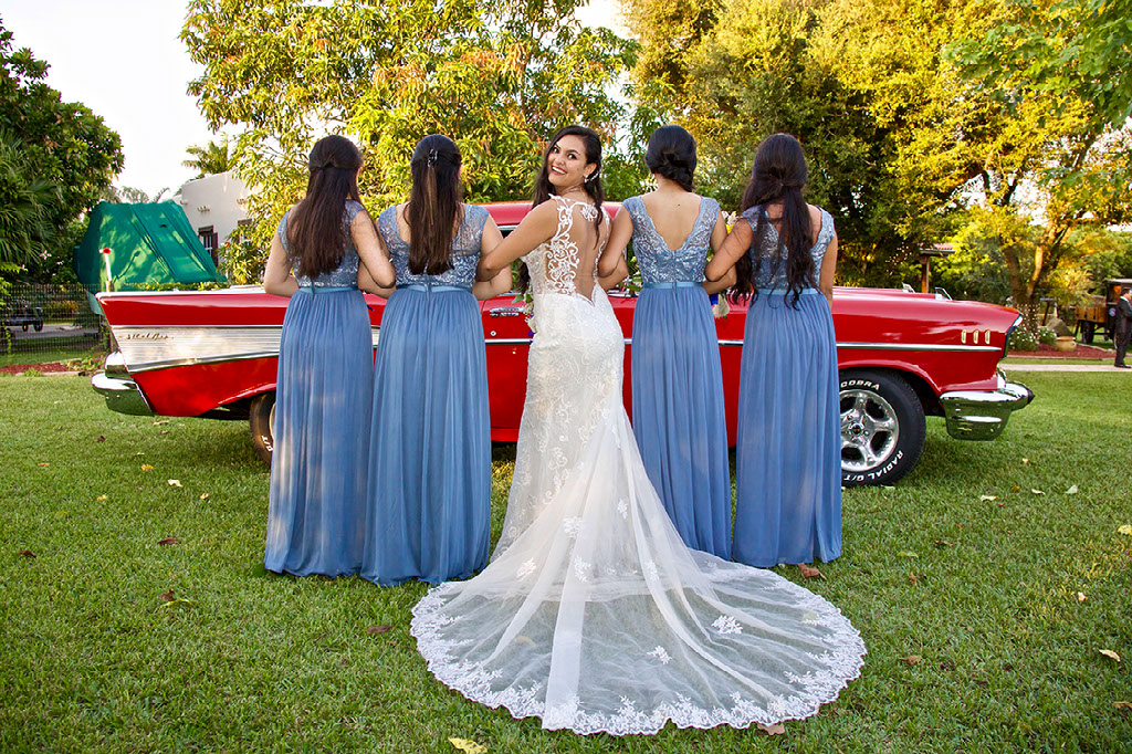 bride and maids antique red car